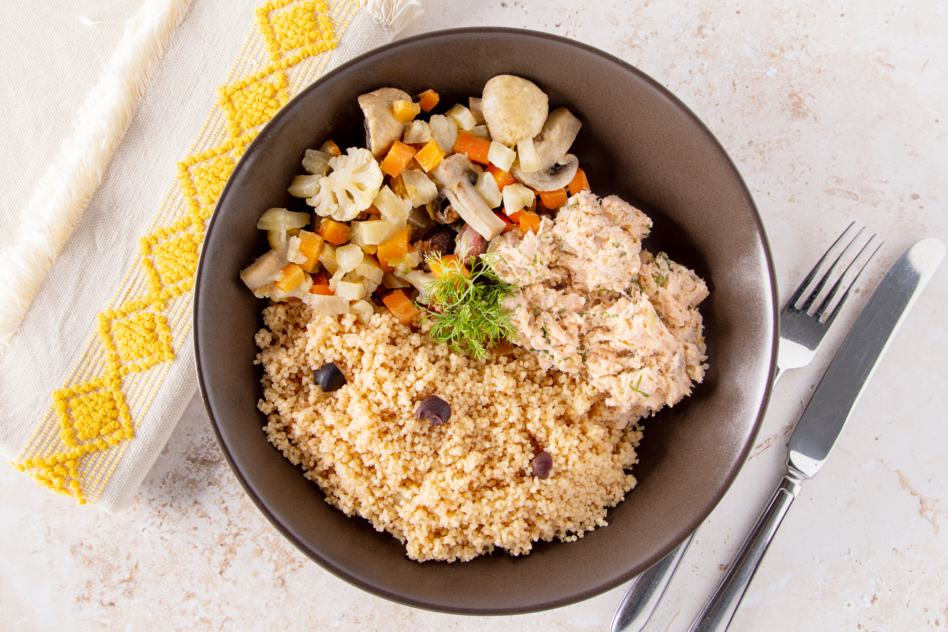 A plate of salmon rillette, couscous and Greek-style vegetables
